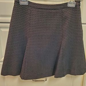 Tweed skirt, flare bottom, side zip and lined.